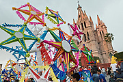 Railroad workers carry giant paper stars in a procession through the city at the start of the week long fiesta of the patron saint Saint Michael September 22, 2017 in San Miguel de Allende, Mexico.
