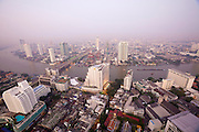 Lebua at State Tower Hotel. Breathtaking view over Chao Phraya River and the skyscrapers at its banks at dawn.