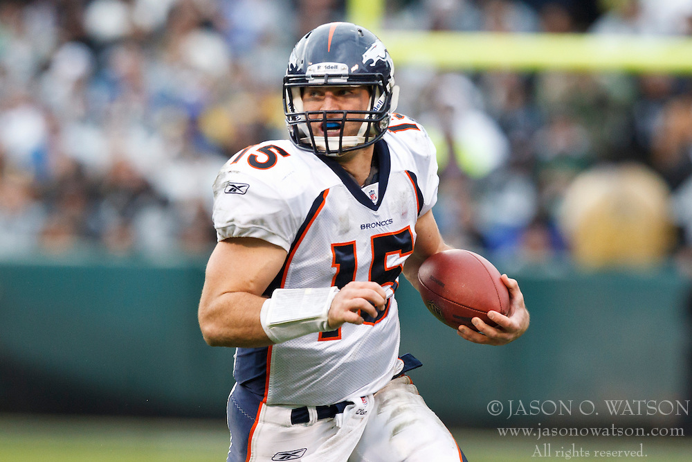 December 19, 2010; Oakland, CA, USA;  Denver Broncos quarterback Tim Tebow (15) rushes up field against the Oakland Raiders during the third quarter at Oakland-Alameda County Coliseum. Oakland defeated Denver 39-23.
