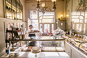 Milan, GIACOMO, la paticceria . Taking inspiration from the old Italian shops and with a glance in the direction of Parisian boulangeries, architects Roberto Peregalli and Laura Sartori Rimini created this little shop featuring mid-19th century flower paintings on the walls and ceiling. The refined but unostentatious setting gives those who step inside its door a pleasing sense of the familiarity of old-time pastry shops.