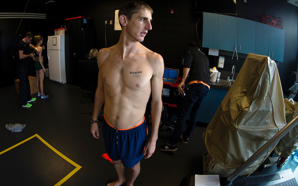 Trent Stellingwerff, applied sport physiologist with a specialization in performance nutrition performs anthropometric measurements on Taylor Milne at the Pacific Institute for Sport Excellence on December 3rd 2015 in Victoria, British Columbia Canada.
