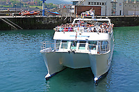 Sight-seeing boat, Ciudad San Sebastian, leaves harbour, San Sebastian, Donostia, Spain, May, 2015, 201505101027<br />