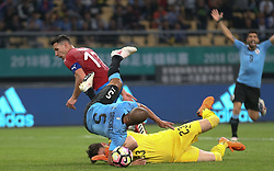 NANNING, March 23, 2018  Carlos Sanchez (No.5) of Uruguay falls during the match between Uruguay and the Czech Republic at the 2018 China Cup International Football Championship in Nanning, capital of south China's Guangxi Zhuang Autonomous Region, March 23, 2018. Uruguay won 2-0.  dx) (Credit Image: © Cao Can/Xinhua via ZUMA Wire)