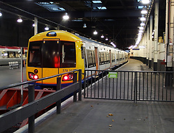 Trains wait on empty platforms in Euston station in Central London, England  after a storm which swept across Southern England disrupting transport after trees fell on the railway lines bringing train travel to a halt in Southern England, United Kingdom. Monday, 28th October 2013. Picture by Max Nash / i-Images