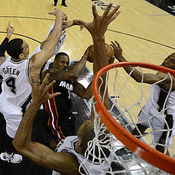 Jun 13, 2013; San Antonio, TX, USA; Miami Heat point guard Mario Chalmers (15) drives to the basket against San Antonio Spurs shooting guard Danny Green (4) during the first half of game four of the 2013 NBA Finals at the AT&T Center. Mandatory Credit: Derick E. Hingle-USA TODAY Sports