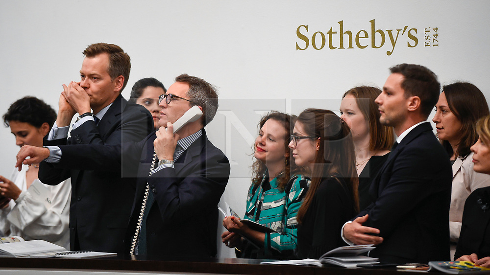 © Licensed to London News Pictures. 19/06/2019. LONDON, UK. Sales staff make bids on behalf of telephone clients at Sotheby's Impressionist & Modern art evening sale in New Bond Street. This is the first major evening sale to take place after Sotheby's agreed to a takeover by media and telecoms billionaire Patrick Drahi in a deal valued at $3.7bn (£2.9bn).  The big five global auction houses (Sotheby's, Christie's, Bonhams, Phillips and China Guardian Auctions) will now be held privately.  Francois Pinault, another French billionaire, owns Sotheby's traditional rival Christie's.   Photo credit: Stephen Chung/LNP
