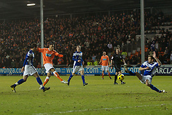 BLACKPOOL, ENGLAND - Tuesday, January 4, 2011: Blackpool's Matt Phillips sees his shot blocked by Birmingham City's Roger Johnson during the Premiership match at Bloomfield Road. (Pic by: David Rawcliffe/Propaganda)