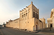 Beit Sheikh Isa Bin Ali Al Khalifa, a traditional Bahraini house built c. 1800 with 4 courtyards and 4 shuttered badqer or wind towers, home of Isa ibn Ali Al Khalifa, 1848–1932, ruler of Bahrain 1869-1932, and seat of his government, in Muharraq, Bahrain. Muharraq is a city on the Pearling Path and with a strong history of pearl diving and pearl trade, where 17 buildings form part of a UNESCO World Heritage Site celebrating the pearl trade. Picture by Manuel Cohen