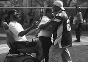 "Coach Rodney ""Rock"" Mason and assistant coach Jamaal Calloway, RIGHT,  try to calm down player William Jones during an emotional loss at Weequahic Park."