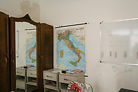 "SUTERA, ITALY - 8 JANUARY 2018: A map of Italy is seen here in a room of a private home used to teach Italian to adult asylum seekers in Sutera, Italy, on January 8th 2018.<br /> <br /> Sutera is an ancient town plastered onto the side of an enormous monolithic rock, topped with a convent, in the middle of the western half of Sicily, about 90 minutes by car south of the Sicilian capital Palermo<br /> Its population fell from 5,000 in 1970 to 1,500 today. In the past 3 years its population has surged  after the local mayor agreed to take in some of the thousands of migrants that have made the dangerous journey from Africa to the Sicily.<br /> <br /> ""Sutera was disappearing,"" says mayor Giuseppe Grizzanti. ""Italians, bound for Germany or England, packed up and left their homes empty. The deaths of inhabitants greatly outnumbered births. Now, thanks to the refugees, we have a chance to revive the city.""<br />  Through an Italian state-funded project called SPRAR (Protection System for Refugees and Asylum Seekers), which in turn is co-funded by the European Union's Fund for the Integration of non-EU Immigrants, Sutera was given financial and resettlement assistance that was co-ordinated by a local non-profit organization called Girasoli (Sunflowers). Girasoli organizes everything from housing and medical care to Italian lessons and psychological counselling for the new settlers.<br /> The school appears to have been the biggest beneficiary of the refugees' arrival, which was kept open thanks to the migrants.<br /> Nunzio Vittarello, the coordinator of the E.U. project working for the NGO ""I Girasoli"" says that there are 50 families in Sutera at the moment."