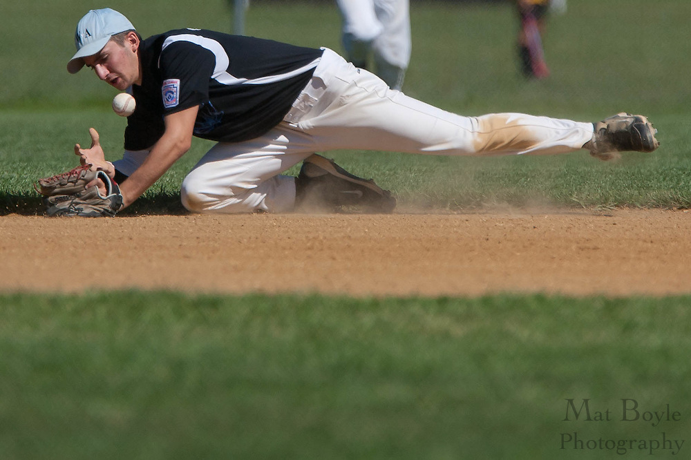 Pennsylvania's Jake Granteed bobbles a ground-ball that he slid to stop in the 2nd inning during the finals of the Eastern Regional Senior League tournament between Pennsylvania and Maryland held in West Deptford on Thursday, August 11.