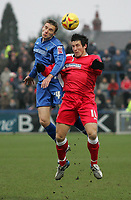 Photo: Paul Thomas.<br /> Macclesfield Town v Swindon Town. Coca Cola League 2. 23/12/2006.<br /> <br /> Kevin McIntyre (L) and Swindon's Lee Peacock jump for the ball.