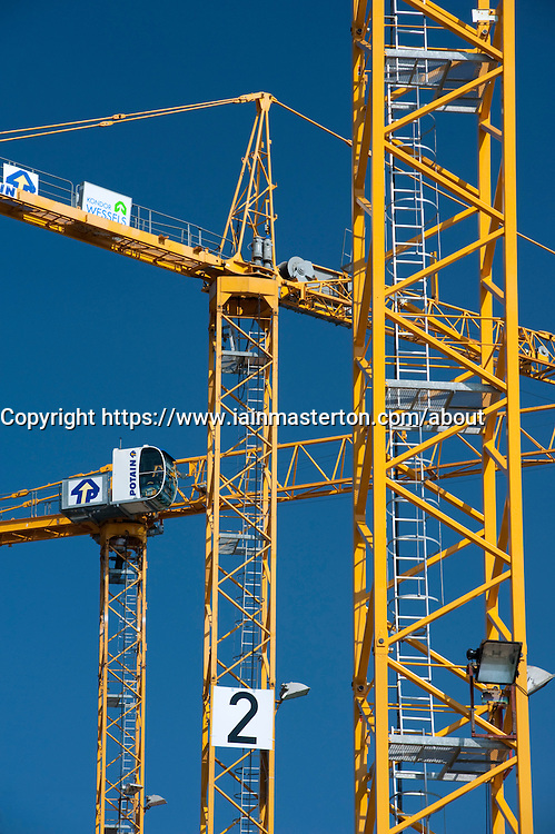 Many tower cranes on a construction site