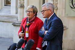 © Licensed to London News Pictures. 19/09/2019. London, UK. JOANNA CHERRY QC MP - SNP MP for Edinburgh South West and JOLYON MAUGHAM QC- lawyer and anti-Brexit campaigner make a statement to the media outside UK Supreme Court in London at the end of the three day appeal hearing in the multiple legal challenges against the Prime Minister Boris Johnson's decision to prorogue Parliament ahead of a Queen's speech on 14 October. Since Tuesday 17 September, eleven instead of the usual nine Supreme Court justices have been hearing the politically charged claim that Boris Johnson acted unlawfully in advising the Queen to suspend parliament for five weeks in order to stifle debate over the Brexit crisis. It is the first time the Supreme Court has been summoned for an emergency hearing outside legal term time. Lady Hale, the first female president of the court who retires next January, has been preside the Brexit-related judicial review cases. Photo credit: Dinendra Haria/LNP