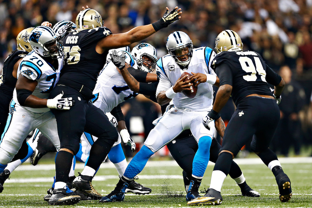 NEW ORLEANS, LA - DECEMBER 8:  Cam Newton #1 of the Carolina Panthers is sacked during a game against the New Orleans Saints at Mercedes-Benz Superdome on December 8, 2013 in New Orleans, Louisiana.  (Photo by Wesley Hitt/Getty Images) *** Local Caption *** Cam Newton