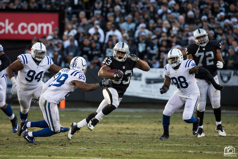 Oakland Raiders running back DeAndre Washington (33) carries the ball against the Indianapolis Colts at Oakland Coliseum in Oakland, Calif., on December 24, 2016. (Stan Olszewski/Special to S.F. Examiner)