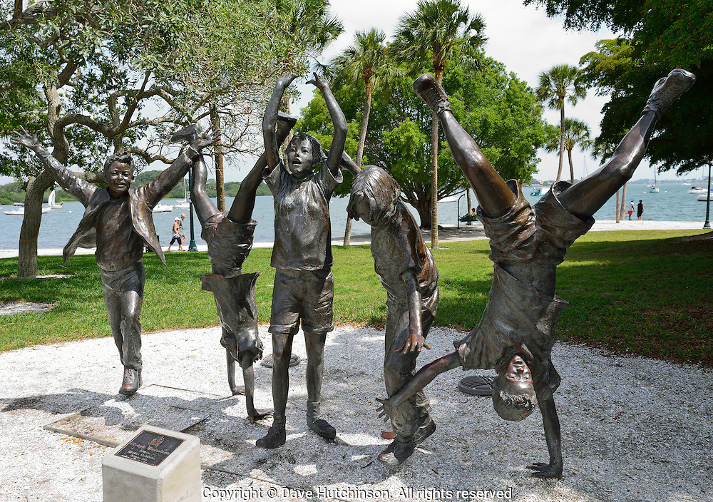 "USA: Sarasota County: Sarasota: ""Olympic Wannabees"" bronze sculpture by Glenna Goodacre at the scenic Island Park area of the Sarasota Bayfront Park is one of numerous public art displays nearby.  Sarasota's waterfront was recently named a great waterfront by USA Today."
