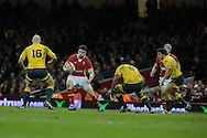 Alex Cuthbert of Wales © looks to go past Stephen Moore (16) and Wycliff Palu (8). Dove Men, autumn international test, Wales v Australia at the Millennium Stadium in Cardiff on Sat 1st Dec 2012. pic by Andrew Orchard, Andrew Orchard sports photography,