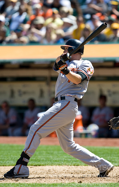 April 18, 2010; Oakland, CA, USA;  Baltimore Orioles left fielder Nolan Reimold (14) at bat against the Oakland Athletics during the fifth inning at Oakland-Alameda County Coliseum. Baltimore defeated Oakland 8-3.