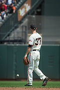 San Francisco Giants second baseman Kelby Tomlinson (37) watches as a ground ball gets past him against the Philadelphia Phillies at AT&T Park in San Francisco, California, on August 20, 2017. (Stan Olszewski/Special to S.F. Examiner)