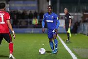 AFC Wimbledon defender Paul Osew (37) taking on Lincoln City midfielder Bruno Andrade (11) during the EFL Sky Bet League 1 match between AFC Wimbledon and Lincoln City at the Cherry Red Records Stadium, Kingston, England on 2 November 2019.