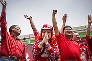 "19 MAY 2013 - BANGKOK, THAILAND:  Red Shirt leaders, including DARUNEE KRITTABOONYALAI, a well known Thai society matron and member of the ruling elite, take the stage during a Red Shirt rally in Ratchaprasong Intersection honoring Red Shirts killed by the Thai army in 2010. Kritboonyalai is a so-called ""HiSo"" or High Society. Most of the Red Shirts are populists and members of the Thai working class and it's unusual for them to have HiSo supporters. More than 85 people, most of them civilians, were killed during the Thai army crackdown against the Red Shirt protesters in April and May 2010. The Red Shirts were protesting against the government of Abhisit Vejjajiva, a member of the opposition who became Prime Minister after Thai courts ruled the Red Shirt supported government was unconstitutional. The protests rocked Bangkok from March 2010 until May 19, 2010 when Thai troops swept through the protest areas arresting hundreds.    PHOTO BY JACK KURTZ"