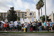 Protesters outside of the DoubleTree Hotel, where John Boehner was scheduled to appear, at day 2 of the RNC in Tampa, FL, on Tuesday, Aug. 28, 2012...Photograph by Andrew Hinderaker for TIME.
