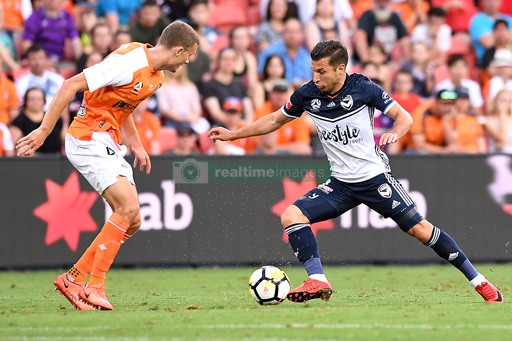 December 17, 2017 - Brisbane, QUEENSLAND, AUSTRALIA - Kosta Barbarouses of Melbourne Victory (9, right) takes on the defence during the round eleven Hyundai A-League match between the Brisbane Roar and the Melbourne Victory at Suncorp Stadium on Sunday, December 17, 2017 in Brisbane, Australia. (Credit Image: © Albert Perez via ZUMA Wire)