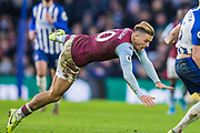 Jack Grealish (Capt) (Aston Villa) flying to the ground during the Premier League match between Brighton and Hove Albion and Aston Villa at the American Express Community Stadium, Brighton and Hove, England on 18 January 2020.