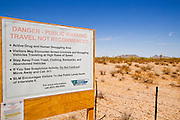 July 12 - GILA BEND, AZ: Signs warning recreational users of the Sonoran Desert National Monument of the dangers of encountering illegal immigrants and drug smugglers on BLM Road 8018c south of Gila Bend, AZ, off of Interstate 8. The Bureau of Land Management (BLM) put up the signs at entrances to the Sonoran Desert National Monument after off roaders reported being shot at by unknown parties and a deputy from the Pinal County Sheriff's Department was fired on and nearly killed by suspected drug dealers. The signs have ignited a firestorm in Arizona politics, conservatives and anti-immigration activists assert that the signs are proof that illegal immigration and drug smuggling is out of control in the area while others suggest that the danger is overstated and the signs are hurting Arizona tourism. A BLM spokesperson said no one has been hurt in the area by confirmed smugglers and that there are very few encounters between smugglers and tourists or off roaders in the monument.    Photo by Jack Kurtz