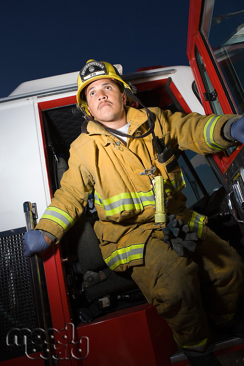 Firefighter exiting fire engine