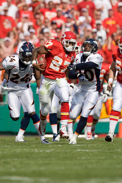 KANSAS CITY, MO - SEPTEMBER 28:   Larry Johnson #27 of the Kansas City Chiefs runs with the ball against the Denver Broncos at Arrowhead Stadium on September 28, 2008 in Kansas City, Missouri.  The Chiefs defeated the Broncos 33-19.  (Photo by Wesley Hitt/Getty Images) *** Local Caption *** Larry Johnson