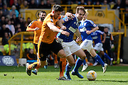 Ipswich Town striker Brett Pitman and Wolverhampton Wanderers defender Danny Batth tussle for the ball during the Sky Bet Championship match between Wolverhampton Wanderers and Ipswich Town at Molineux, Wolverhampton, England on 2 April 2016. Photo by Alan Franklin.
