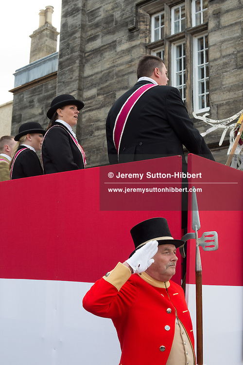 The installation of the Cornet at the Old Parish Church steps, at The Peebles Beltane Festival, including their Common Riding of the Marches, with Cornet Daniel Williamson, and Cornets Elect Lass Susan Thomson, in Peebles, Scotland, Wednesday 19th June 2013. <br /> N55&deg;39.072'<br /> W3&deg;11.548'