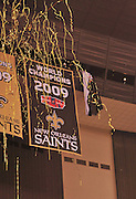 "Owner/Executive Vice President Rita Benson LeBlanc cheers, while her grandfather and owner Tom Benson has his hand on the Lombardi Trophy, as the World Champioship Banner is nveiled in the New Orleans Super Dome for the first time ever Thursday Sept. 9,2010. World Champion New Orleans Saints owner Tom Benson struts on the field sporting a one of a kind hand made ""special ""pinstripe suit"" The striping says "" New Orleans Saint World Champions"" all over the  Black & Gold Suit!!! His wife Gayle , on his arm,had it made for him as a surpirse and he was presented it right before opening of the NFL season in New Orleans Louisiana Thurs Sept. 9,2010. The Saints beat the Minnessota Viking 14-9. Phot © Suzi Altman"