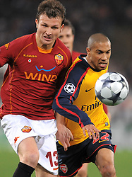 Marco Motta and Gael Clichy in action during the UEFA Champions League, Round of Last 16, Second Leg match between AS Roma and Arsenal at the Stadio Olimpico on March 11, 2009 in Rome, Italy.