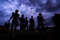 The Oak Ridge Trojans head out to arm up before the game as the Oak Ridge Trojans football team host the Folsom Bulldogs, Friday Nov 3, 2017.<br /> photo by Brian Baer