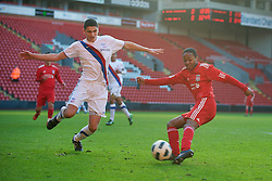 LIVERPOOL, ENGLAND - Saturday, January 8, 2011: Liverpool's Raheem Sterling and Crystal Palace's Ryan Inniss during the FA Youth Cup 4th Round match at Anfield. (Pic by: David Rawcliffe/Propaganda)