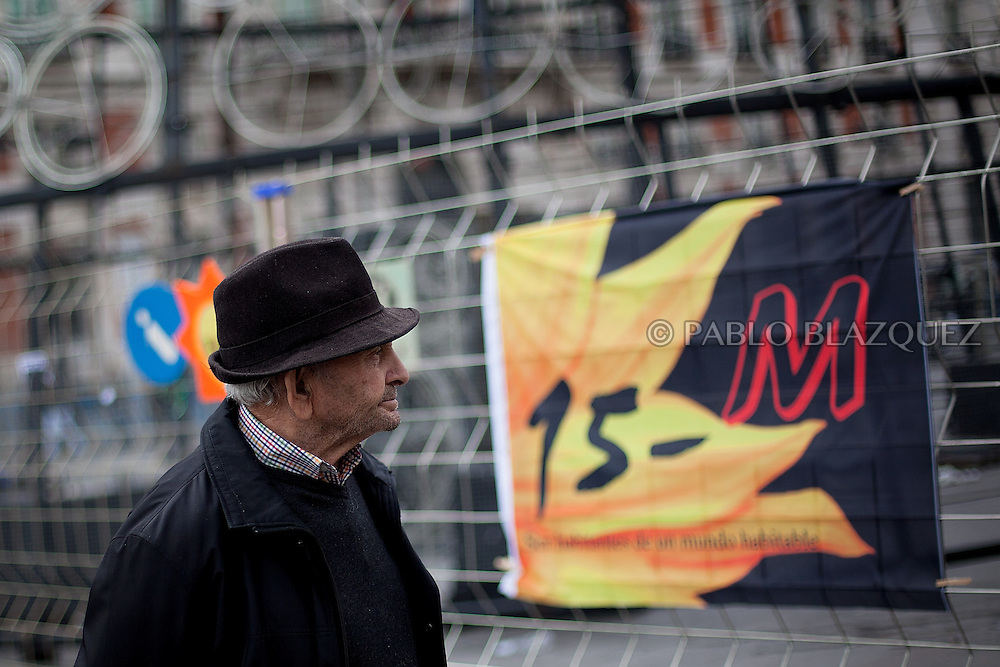 A man attends a 'indignant' demonstration in the Puerta del Sol square in Madrid on November 19, 2011 against spending cuts, high unemployment and political corruption, one day before general election. Spain's so-called 'indignant' protest movement was born when thousands of people set up camp in Madrid's Puerta del Sol square ahead of May 22 municipal elections.
