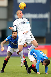 Dundee's Kenny Miller (centre) and Rangers' Andy Halliday (right) battle for the ball during the Scottish Premiership match at Dens Park, Dundee.
