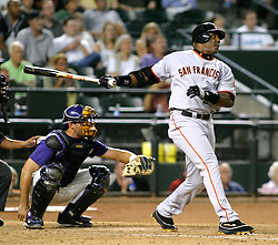 Phoenix, AZ 07-20-04 San Francisco Giants' Barry Bonds hits a double in the 8th inning. Bonds had only one hit in 4 at bats in a 3-1 win over the Arizona Diamondbacks. Ross Mason photo