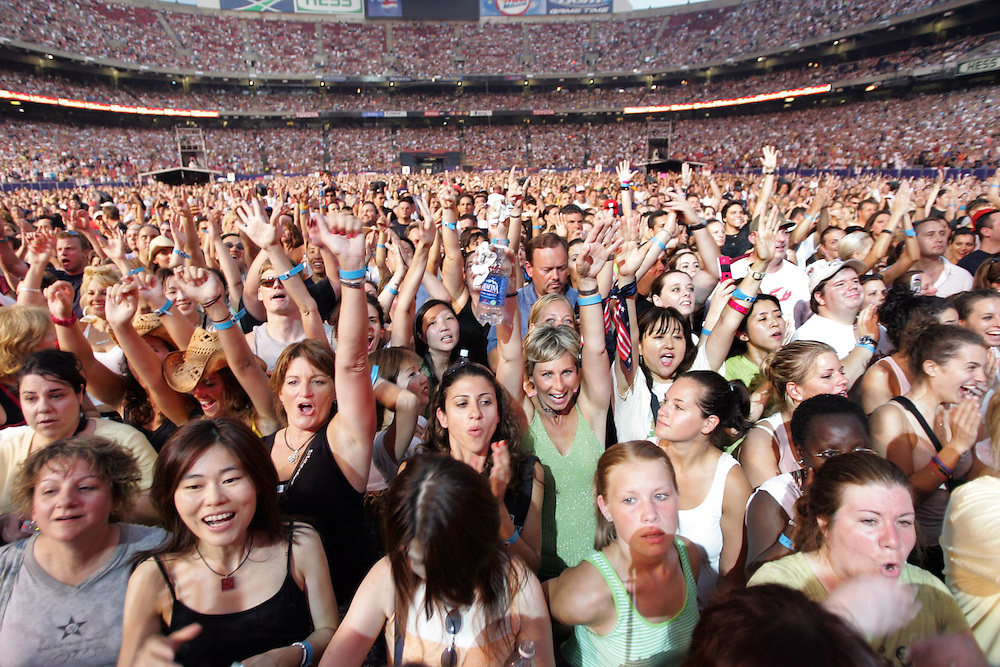 (PPAGE1) East Rutherford 7/18/2006   A jammed pack Giants stadium for the Bon Jovi concert.   Here fans react to the band coming on stage.  Michael J. Treola Staff Photographer.....MJT