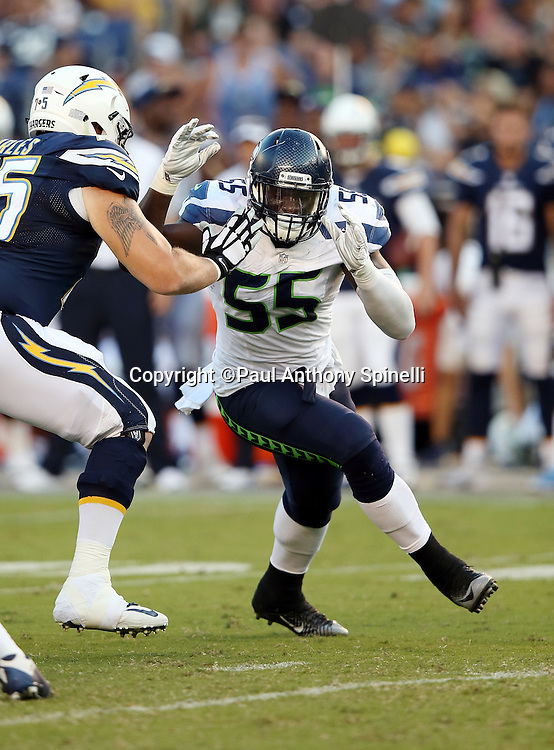 Seattle Seahawks defensive end Frank Clark (55) rushes while being blocked by San Diego Chargers guard Jeremiah Sirles (75) during the 2015 NFL preseason football game against the San Diego Chargers on Saturday, Aug. 29, 2015 in San Diego. The Seahawks won the game 16-15. (©Paul Anthony Spinelli)