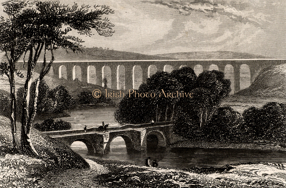 Pont-y-Cysyllte aqueduct on the Ellesmere Canal where it passes through the Vale of Llangollen, Wales.  The most notable of all the iron trough aqueducts in Britain.  Built by Thomas Telford (1757-1834) Scottish civil engineer.  Opened in 1805, it is 307 metres long, with 19 arches and is 30.7 metres above the river Dee.  It cost £47,018.  Lithograph.