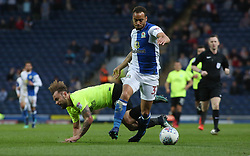 Danny Lloyd of Peterborough United in action with Elliott Bennett of Blackburn Rovers - Mandatory by-line: Joe Dent/JMP - 19/04/2018 - FOOTBALL - Ewood Park - Blackburn, England - Blackburn Rovers v Peterborough United - Sky Bet League One