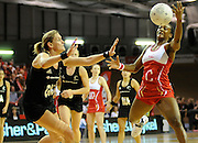 Serena Guthrie grabs the ball for England, during New World Netball Series, New Zealand Silver Ferns v England at The ILT Velodrome, Invercargill, New Zealand. Thursday 6 October 2011 . Photo: Richard Hood photosport.co.nz