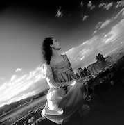 Woman on Stone Fence near Maitland, NSW, Australia