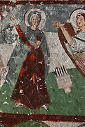 Fresco of the Annunciation, detail, in Pancarlik Kilise or Pancarlik Church, early 11th century, in the Pancarlik Valley, Nevsehir province, Cappadocia, Central Anatolia, Turkey. The churches are carved from the soft volcanic tuff created by ash from volcanic eruptions millions of years ago. Early christians came here to flee persecution by the Romans and others settled here under the influence of early saints. This area forms part of the Goreme National Park and the Rock Sites of Cappadocia UNESCO World Heritage Site. Picture by Manuel Cohen