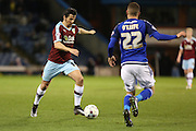 Joey Barton of Burnley gets a shot away under pressure from Stuart O'Keefe of Cardiff City during the Sky Bet Championship match between Burnley and Cardiff City at Turf Moor, Burnley, England on 5 April 2016. Photo by Simon Brady.