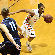 New Hanover's Shawn Robinson drives on Hoggard's Jack Bagley. (Jason A. Frizzelle)